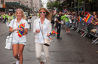 TD Bank employees and supporters in the annual Lesbian, Gay, Bisexual and Transgender Pride Parade on Fifth Avenue in New York on Sunday, June 28, 2015. The parade was particularly boisterous due to the recent Supreme Court decision on same-sex marriage. The parade is the largest gay pride parade in the world.(© Richard B. Levine)