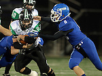 SIOUX FALLS, SD - OCTOBER 23: Jerry Kappenman #32 from McCook Central Montrose tries to elude the grasp of Sawyer Prins #8 from Sioux Falls Christian in the first half of their game Thursday night at Bob Young Field. (Photo by Dave Eggen/Inertia)