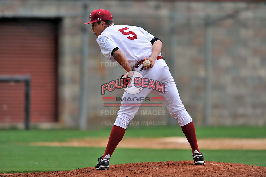 Asheville Cougars starting pitcher Josh Hall #5 delivers a pitch during a game against the T.C. Roberson Rams  at Asheville High on April 15, 2013 in Asheville, North Carolina. The Rams won 4-1. (Tony Farlow/Four Seam Images).