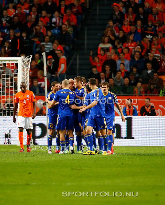 Nederland, Amsterdam, 10 oktober 2014<br /> Seizoen 2014-2015<br /> EK Kwalificatiewedstrijd <br /> Nederland-Kazachstan <br /> Kazachstan viert het doelpunt van Renat Abdulin, de 0-1. Links Bruno Martins Indi van Nederland.