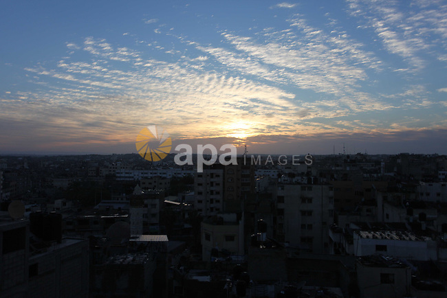 The sunrise is seen over Gaza City on New Year's Day on January 1, 2019. Photo by Mahmoud Ajjour