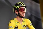 Race leader Adam Yates (GBR) Mitchelton-Scott at sign on before Stage 7 of the Criterium du Dauphine 2019, running 133.5km from Saint-Genix-les-Villages to Les Sept Laux - Pipay, France. 15th June 2019.<br /> Picture: ASO/Alex Broadway | Cyclefile<br /> All photos usage must carry mandatory copyright credit (© Cyclefile | ASO/Alex Broadway)