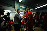 Stamford AFC 2 Marine 4, 29/03/2014. Wothorpe Road, Northern Premier League. Stamford players in the changing room encourage each other ahead of The Northern Premier League game between Stamford AFC and Marine from The Daniels Stadium. Marine won the game 4-2 in front of 320 supporters to boost their chances of relegation survival. Stamford AFC are moving to the brand new Zeeco Stadium at the end of the 2013/14 season. Photo by Simon Gill.