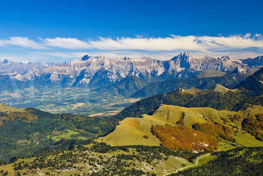View from La Montagnette in the Upper Vallon du Combeau. Vercors. Drome. Diois, towards the mountains of the Isere and across the valleys of the Buech and the Drac. France.