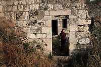 A Palestinian woman is seen as she visits the ruins of Lifta, a Palestinian village in the outskirts of Jerusalem, whose Palestinian inhabitants fled in 1948. The village, the last standing Palestinian village of its kind, is about to be turned into a luxury Israeli neighborhood,  Photo by Quique Kierszenbaum