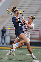 College Park, MD - February 25, 2017: Maryland Terrapins Jen Giles (5) knocks the ball out of North Carolina Tar Heels Carly Reed (16) stick during game between North Carolina and Maryland at  Capital One Field at Maryland Stadium in College Park, MD.  (Photo by Elliott Brown/Media Images International)