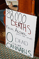 "A sign reading ""88,000 Deaths from Alcohol (2006-2010 CDC.gov) 0 dead from Cannabis"" rests against a seat at a campaign rally for Green Party presidential nominee Jill Stein at Old South Church in Boston, Massachusetts, on Sun., Oct. 30, 2016. The sign is likely a reference to the Question 4 Ballot Initiative on the 2016 ballot which would make recreational marijuana use legal in the state."