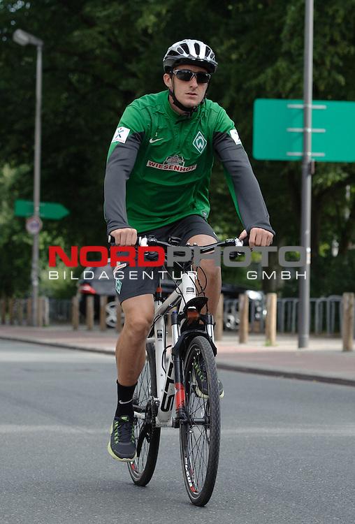 11.08.2013, Trainingsgelaende, Bremen, GER, 1.FBL, Training Werder Bremen, im Bild Luca Caldirola (Bremen #3) auf dem Fahrrad<br /> <br /> Foto &copy; nph / Frisch