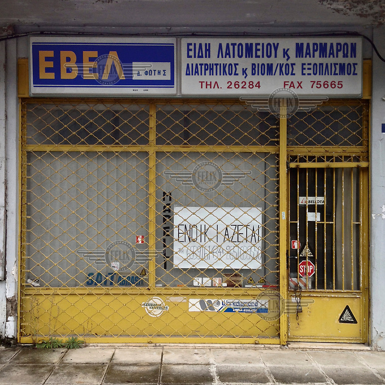 A closed down shop on Makrygianni Street that sold equipment to the quarry and mining industry. A 'To Rent' sign has been placed in the window.