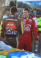 Feb 29, 2008; Las Vegas, NV, USA; NASCAR Sprint Cup Series driver Carl Edwards (right) congratulates Kyle Busch during qualifying for the UAW Dodge 400 at Las Vegas Motor Speedway. Mandatory Credit: Mark J. Rebilas-US PRESSWIRE