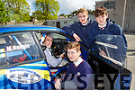 Rally driver Pat Cahman shows St Brendans College students Pierce Lyne-Roberts, Cael O'Donoghue and Thomas McCluskey some tips  at the Road Safety Promoation held by The Road Safety Authority and Killarney Motor and District club held in St Brendans College on Tuesday morning