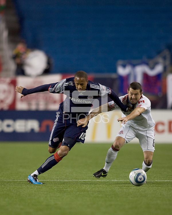 New England Revolution midfielder Khano Smith (18) accelerates as Toronto FC forward Dan Gargan (8) defends. The New England Revolution defeated Toronto FC, 4-1, at Gillette Stadium on April 10, 2010.