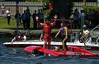 Regates de Valleyfield, 6-8 July,2001 Salaberry de Valleyfield, Quebec, Canada.Copyright©F.Peirce Williams 2001.Frame 9: CE-222, 5 Litre class hydroplane, races into turn two hops once and hooks to the left, digs in with the left side and flips over. With help from the rescue team the driver climbs out trough the bottom hatch unhurt...F. Peirce Williams .photography.P.O.Box 455  Eaton, OH 45320.p: 317.358.7326  e: fpwp@mac.com