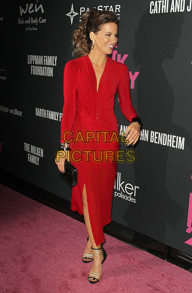 Kate Beckinsale<br /> The Pink Party 2013 held at the Santa Monica Airport, Santa Monica, California, USA.<br /> October 19th, 2013<br /> full length dress red black clutch bag  wrap slit split profile <br /> CAP/ADM/KB<br /> &copy;Kevan Brooks/AdMedia/Capital Pictures