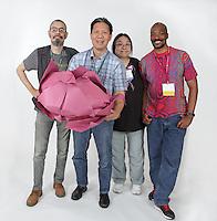 OrigamiUSA 2016 Convention at St. John's University, Queens, New York, USA. Oversized 9' x 9' paper folding event. Left to right: Francois Desarmenien, France, Tan Le, MN, Elsa Chen, MA, Denver Lawson, UK.