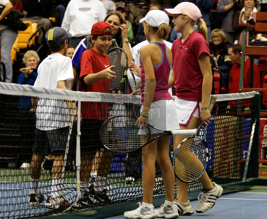 Jess Jones (from left), Nikita Kardivar, Andiak Daniel and Hannah King shake hands after their match--the boys won--during the FedEx Shootout Atlanta at Kennesaw State University on Saturday, Dec. 9, 2006.