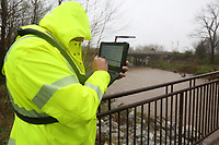 Neil Holloway, with the United States Geological Survey, prepares to take a sample Thursday, March 19, 2020, from a bridge on the Razorback Greenway over Clear Creek in Johnson. The survey monitors several creeks and waterways including taking storm event samples. Check out nwaonline.com/200320Daily/ and nwadg.com/photos for a photo gallery.<br /> (NWA Democrat-Gazette/David Gottschalk)