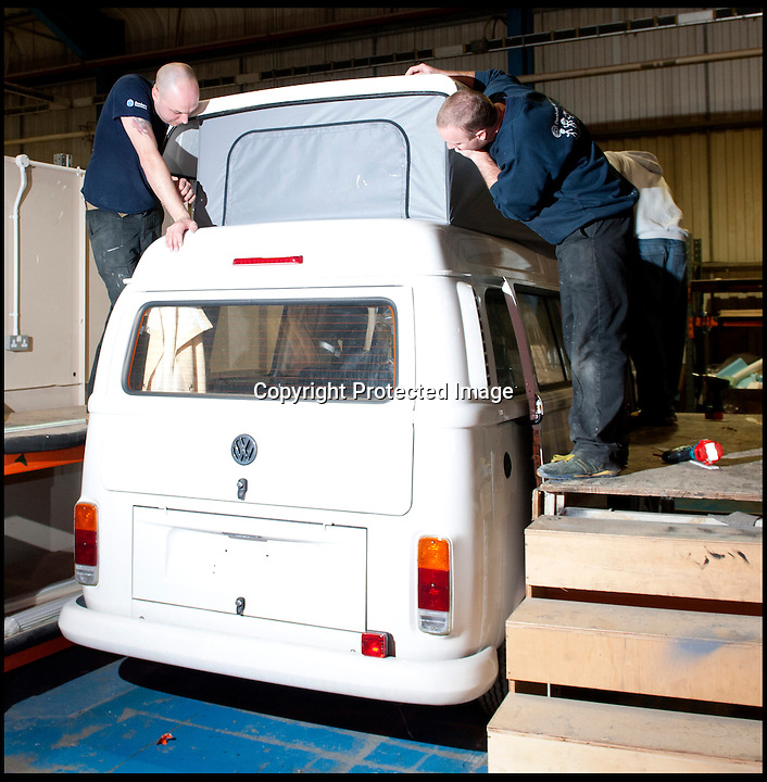 BNPS.co.uk (01202 558833)<br /> Pic: LauraJones/BNPS<br /> <br /> One of the campervans having it's pop top fitted. <br /> <br /> The last ever delivery of brand new Volkswagen campervans has arrived in Britain marking the end of an era for the iconic 'hippy bus'.<br /> <br /> Ninety nine of the final batch of vans rolled off the production line and onto a container ship bound for British shores after manufacture ceased for good in Brazil in December.<br /> <br /> And though the consignment has only just arrived, almost all of the vans have already been snapped up by eager buyers happy to fork out the &pound;35,000 starting price.<br /> <br /> They are the last brand new campers in all of Europe.