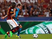 Calcio, Champions League, Gruppo E: Roma vs Barcellona. Roma, stadio Olimpico, 16 settembre 2015.<br /> Roma&rsquo;s Antonio Ruediger, left, and FC Barcelona&rsquo;s Ivan Rakitic fight for the ball during a Champions League, Group E football match between Roma and FC Barcelona, at Rome's Olympic stadium, 16 September 2015.<br /> UPDATE IMAGES PRESS/Riccardo De Luca