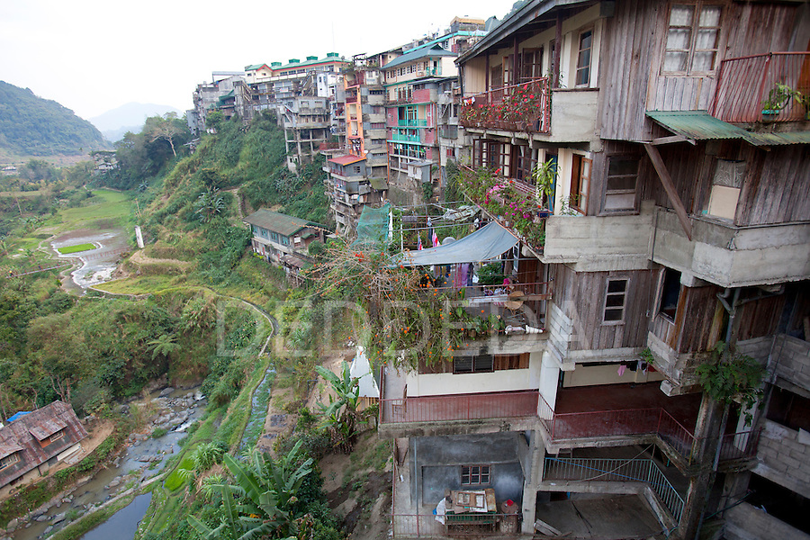 The houses and shops in the small city of Banaue, famous for its ancient mud-walled rice terraces, in the Cordillera region of North Luzon, Philippines.