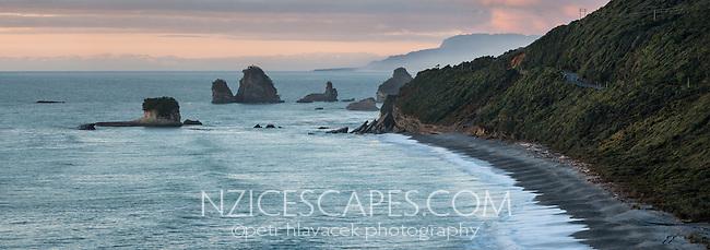 Sunset on wild coastline near Rapahoe near Greymouth with coastal road on right, West Coast, Buller Region, South Island, New Zealand, NZ