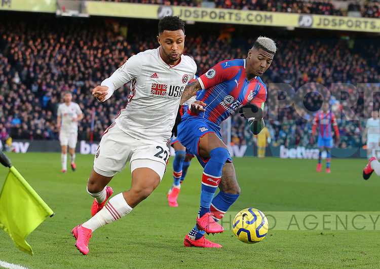 Sheffield United's Lys Mousset and Crystal Palace's Patrick van Aanholt challenge for the ball during the Premier League match at Selhurst Park, London. Picture date: 1st February 2020. Picture credit should read: Paul Terry/Sportimage