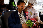 Men chew qat while they wait for their shared taxi to depart for Aden in Taezz, Yemen, Nov. 30, 2009. Lawlessness, growing poverty, a water crisis, a raging conflict with Houthi rebels in Yemen's north and clashes with separatists in the South continue to destabilize the Arabian Peninsula's poorest state.