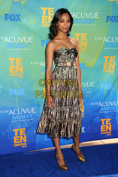 Zoe Saldana.2011 Teen Choice Awards - Arrivals held at Gibson Amphitheatre, Universal City, California, USA..August 7th, 2011.full length strapless gold knot knotted strapless dress silver bronze metallic  .CAP/ADM/BP .©Byron Purvis/AdMedia/Capital Pictures.