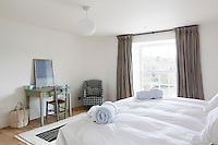 One of three family bedrooms on the first floor has a view over the estuary