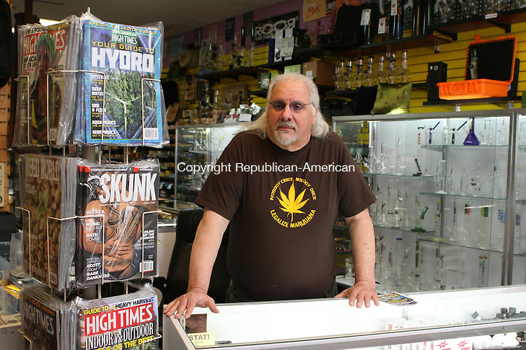 WATERBURY, CT, 07 April, 2016 - 040716LW02 - John Carusello stands next to copies of marijuana magazines at his Lifestyles shop on Lakewood Road in Waterbury. <br />