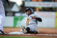 Hudson Valley Renegades center fielder Garrett Whitley (24) slides into third base during a game against the Batavia Muckdogs on July 31, 2016 at Dwyer Stadium in Batavia, New York.  Hudson Valley defeated Batavia 4-1.  (Mike Janes/Four Seam Images)