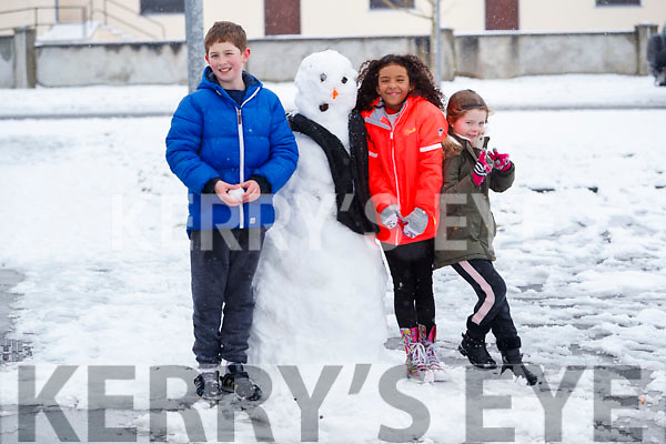 Jayden Breen Layla Mitchell and Amy O'Sullivan in the snow in Abbeydorney on Friday.