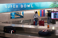 MIAMI FLORIDA - JANUARY  22: People Arrive to the International Airport on January 22, 2020 in Miami, Florida. Miami is getting ready for Super Bowl as thousands of tourists descend on the state to celebrate the biggest sporting event of the year. (Photo by Eduardo Munoz / VIEWpress).