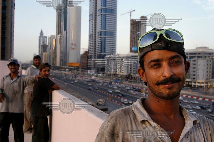 A group of South Asian construction workers during a break from work.