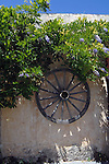 Wheel on country cottage surrounded with wisteria, Tenerife countryside, Canary Islands