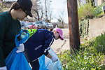 Volunteers Micaela Vickers, left, and Hope Bowden pick up trash along Mound Street during Athens Beautification Day on April 9, 2017.