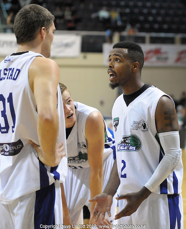 Rangers guard Carl Buck talks to Patrich Bolstad during the national basketball league match between Wellington Saints and Waitakere Rangers at TSB Bank Arena, Wellington, New Zealand on Tuesday, 25 June7 May 2013. Photo: Dave Lintott / lintottphoto.co.nz