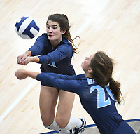 NWA Democrat-Gazette/J.T. WAMPLER Springdale Har-Ber's Lauren Thompson (right) and Jayci Carpenter chase the ball against Fayetteville Tuesday Oct. 10, 2017 at Wildcat Arena in Springdale. Springdale Har-Ber beat Fayetteville in 5 sets (22-25, 25-19, 25-21, 23-25, 20-18).