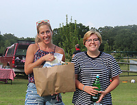 Robyn King (left) and Hannah King pick up their Apple Seeds picnic on July 16 in Fayetteville.<br /> (NWA Democrat-Gazette/Carin Schoppmeyer)