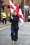 © Joel Goodman - 07973 332324 . 02/04/2011 . Blackburn , UK . An EDL supporter carrying an England flag . The English Defence League ( EDL ) hold a demonstration in Blackburn . Photo credit : Joel Goodman