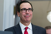 US Treasury Secretary Steven Mnuchin attends the signing of a presidential proclamation on steel and aluminum tariffs by US President Donald J. Trump, in the Roosevelt Room of the White House in Washington, DC, USA, 08 March 2018. President Trump is imposing tariffs on steel and aluminum imports. A decision to impose the tariffs on Canada or Mexico will not be decided until negotiations on the North American Free Trade Agreement (NAFTA).<br /> Credit: Michael Reynolds / Pool via CNP