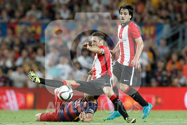 FC Barcelona's Luis Suarez (l) and Athletic de Bilbao's Carlos Gurpegui (c) and Benat Etxebarria during Supercup of Spain 2nd match.August 17,2015. (ALTERPHOTOS/Acero)