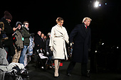 United States President Donald J. Trump with first lady Melania Trump walk back to the stage during the 2018 National Christmas Tree lighting ceremony at the Ellipse near the White House in Washington, DC on November 28, 2018. <br /> Credit: Oliver Contreras / Pool via CNP