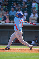 Dan Vogelbach (21) of the Tennessee Smokies follows through on his swing against the Birmingham Barons at Regions Field on May 3, 2015 in Birmingham, Alabama.  The Smokies defeated the Barons 3-0.  (Brian Westerholt/Four Seam Images)