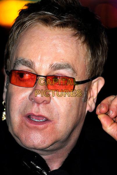 "ELTON JOHN .""It's A Boy Girl Thing"" World Charity Premiere, Odeon West End, London, UK..December 18th 2006.headshot portrait sunglasses shades.CAP/IA.©Ian Allis/Capital Pictures"