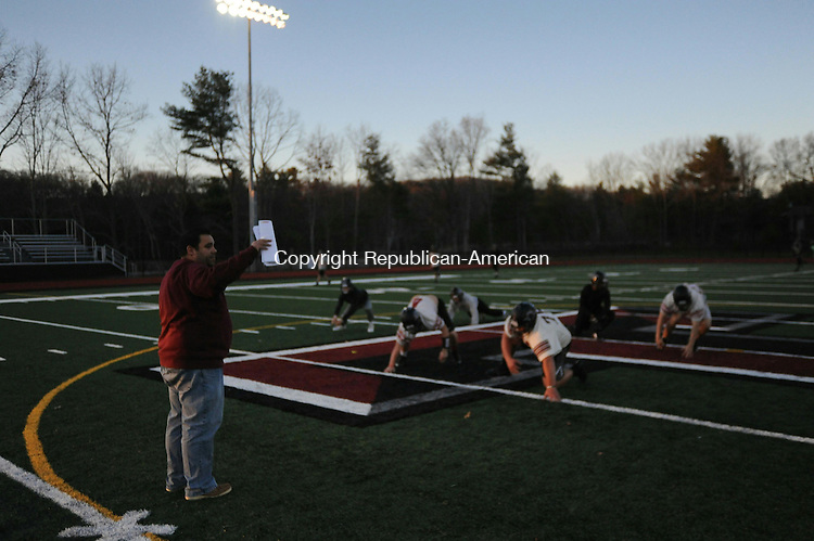 TORRINGTON, CT- 21 November 2015- 112115BJ03-- Torrington High School football coach Gaitan Rodriguez gives instructions to the players during practice on Friday. The football team has been recognizezd by the Western Connecticut Football Officials Association for good sportsmanship. Bruno Matarazzo Jr. Republican-American