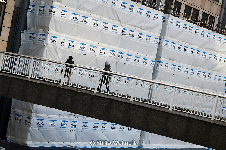 Plastic safety screens cover scaffolding on a Bovis Lend Lease construction site in the City of London.