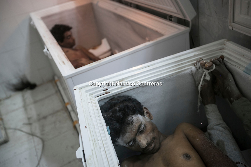July 05, 2015 - Hajjah, Yemen: The bodies of two civilians lay at the morgue of  Jamhoony hospital in Hajjah city after he arrived from Harad, a border town where a fighter jet of the Saudi-led coalition dropped a bomb over a market place killing 30 and leaving 67 severely wounded. (Photo/Narciso Contreras)