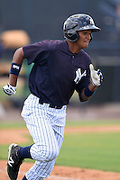 GCL Yankees 1 outfielder Leonardo Molina (18) runs to first during the second game of a doubleheader against the GCL Braves on July 1, 2014 at the Yankees Minor League Complex in Tampa, Florida.  GCL Braves defeated the GCL Yankees 1 by a score of 3-1.  (Mike Janes/Four Seam Images)