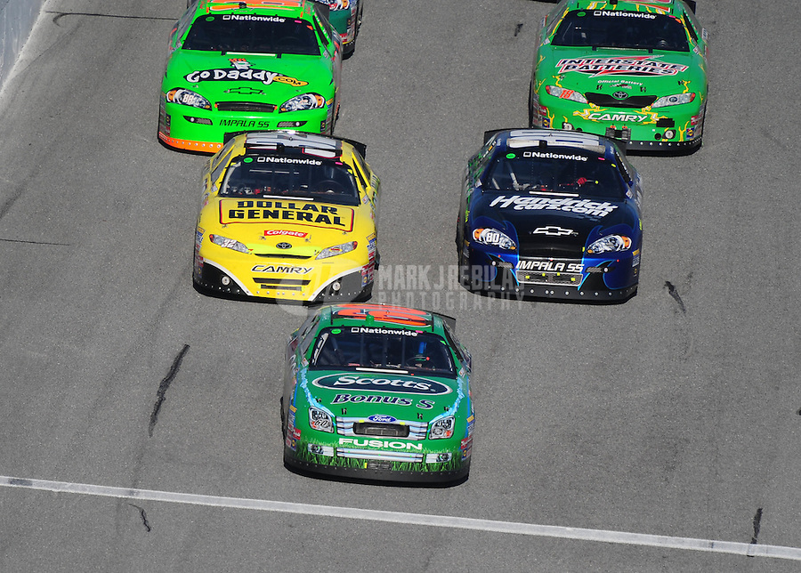 Feb 14, 2009; Daytona Beach, FL, USA; NASCAR Nationwide Series driver Carl Edwards (60) leads Brian Vickers (32) and Tony Stewart (80) during the Camping World 300 at Daytona International Speedway. Mandatory Credit: Mark J. Rebilas-